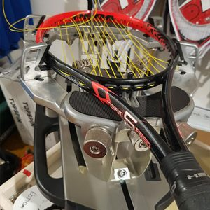 Tennis racquet re-stringing