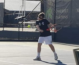 Tennis player wearing Solar Bat Sunglasses